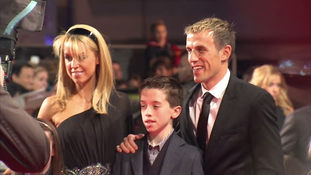 exterior shots of former manchester uniter football player and current manchester united coach phil neville posing on the red carpet with his family... - documentary film stock videos & royalty-free footage