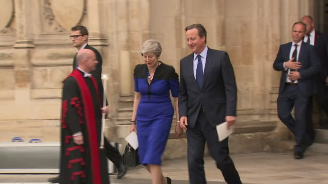 exterior shots of former prime minister david cameron and prime minister theresa may together walking from westminster abbey after a memorial service... - david cameron politician stock videos & royalty-free footage