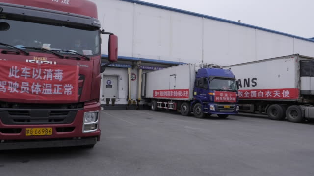 exterior shots of freight trucks parked at the distribution centre of a chinese dairy for loading on 27 february 2020 in beijing, china - stationary stock-videos und b-roll-filmmaterial