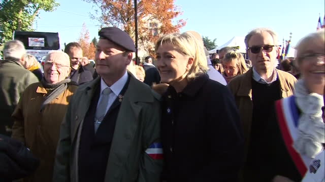 exterior shots of french national front leader marine le pen meeting the public and shaking hands during an armistice day ceremony on november 11... - populism stock videos and b-roll footage