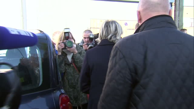 exterior shots of french national front leader marine le pen walking to car and departing arfter armistice day ceremony in henin beaumont on november... - armistice stock videos and b-roll footage