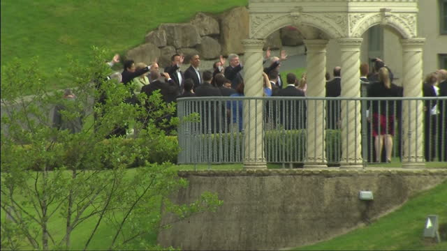 exterior shots of g8 leaders walking towards photocall all wave for a photo and us president barack obama walks and talks over bridge with canadian... - day 2 stock videos & royalty-free footage