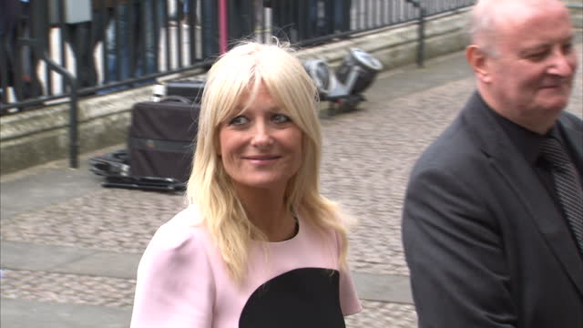 exterior shots of gaby roslin simon mayo arriving for a memorial service for sir terry wogan at westminster abbey and posing for the press on... - terry wogan video stock e b–roll