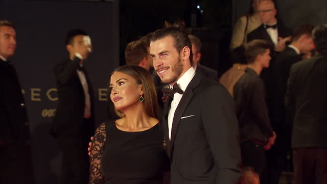 exterior shots of gareth bale and emma rhysjones attending the royal world premiere of 'spectre' at royal albert hall on october 26 2015 in london... - spectre 2015 film stock videos and b-roll footage
