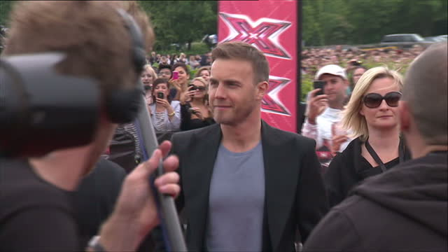 exterior shots of gary barlow, take that, singer, songwriter, musician and new x factor judge arriving for x factor auditions, walking from car... - the x factor stock videos & royalty-free footage