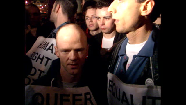 exterior shots of gay rights campaigners peter tatchell and jimmy sommerville talking to camera holding placards at an outrage protest on march 19... - pride stock videos & royalty-free footage