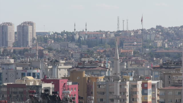 Exterior shots of Gaziantep's city skyline with the rooftops of houses tower blocks and mosques on October 10 2015 in Gaziantep Turkey