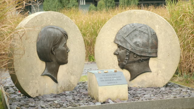 exterior shots of gchq in cheltenham including a memorial to those lost in conflict and a spherical water feature on 1 november 2019 in cheltenham... - sphere stock videos & royalty-free footage