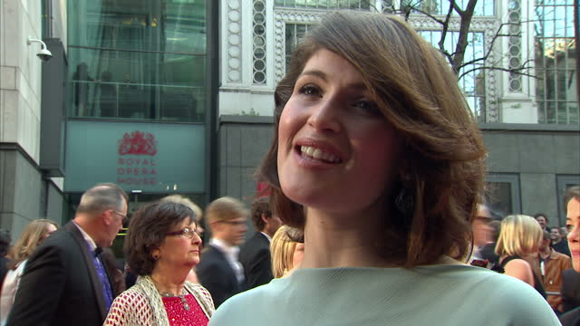 Exterior shots of Gemma Arterton giving an interview on the red carpet at the Olivier Awards on April 13 2014 in London United Kingdom