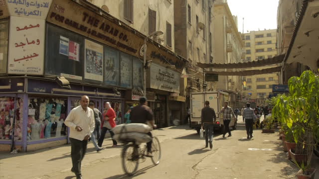 exterior shots of general day to day life around cairo including people sat outside a cafe chatting a doner kebab shop and people walking in the... - cairo stock videos & royalty-free footage