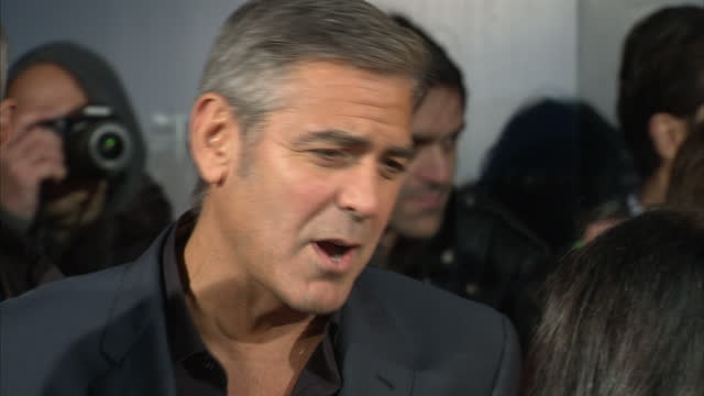 Exterior shots of George Clooney being interviewed by media on red carpet at premiere of The Ides of March