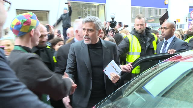 Exterior shots of George Clooney meeting members of the public and departing in a car whilst on a vist to Edinburgh on November 12 2015 in Edinburgh...