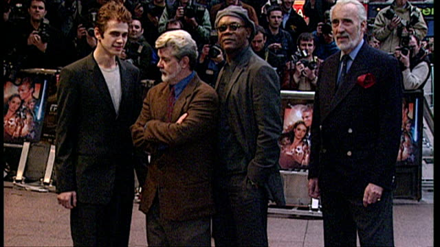 Exterior shots of George Lucas Christopher Lee Hayden Christensen posing for photos and Samuel L Jackson join them at the premiere of Star Wars...