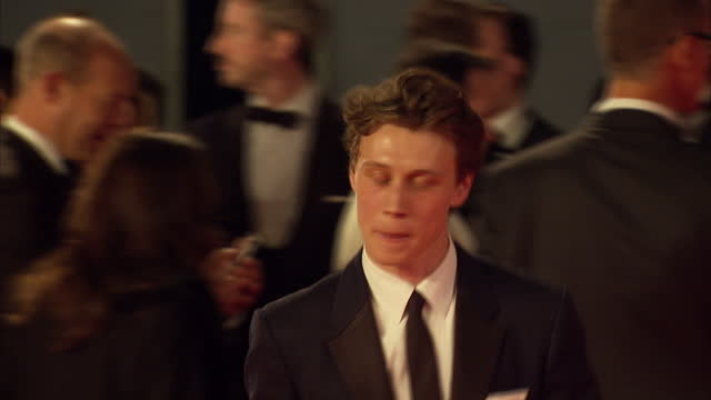 exterior shots of george mackay attending the royal world premiere of 'spectre' at royal albert hall on october 26 2015 in london england - spectre 2015 film stock videos and b-roll footage