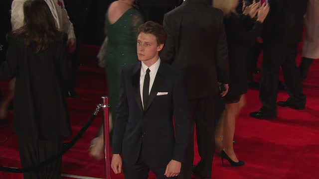 stockvideo's en b-roll-footage met exterior shots of george mackay attending the royal world premiere of 'spectre' at royal albert hall on october 26 2015 in london england - george mackay