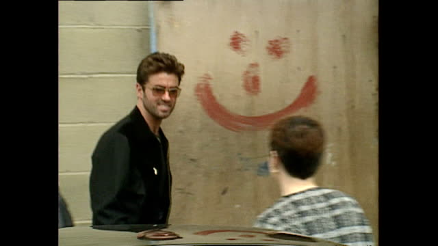 exterior shots of george michael arriving at freddie mercury tribute concert rehearsals on april 19, 1992 in london, england. - gedenkveranstaltung stock-videos und b-roll-filmmaterial