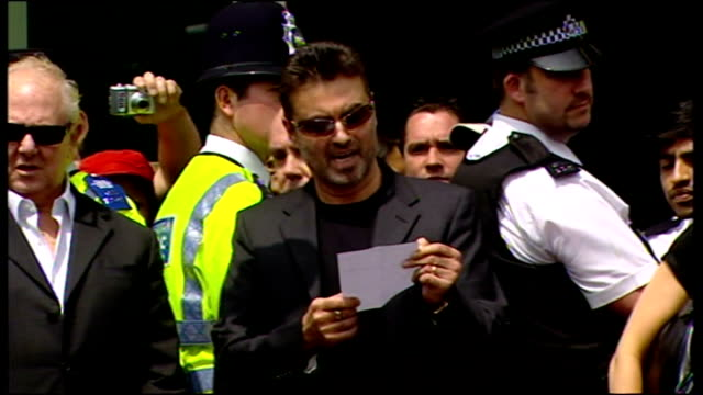 exterior shots of george michael departing brent magistrates court and give press statement about his sentencing on drug driving offence on june, 08... - musician stock videos & royalty-free footage