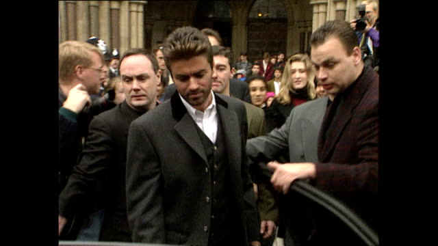exterior shots of george michael departing the royal courts of justice during case against sony music entertainment on october 28, 1993 in london,... - sony stock-videos und b-roll-filmmaterial