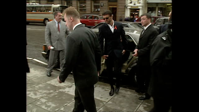 exterior shots of george micheal arriving at court during trial case against sony music entertainment and shots of crowds gathered outside of the... - sony stock-videos und b-roll-filmmaterial