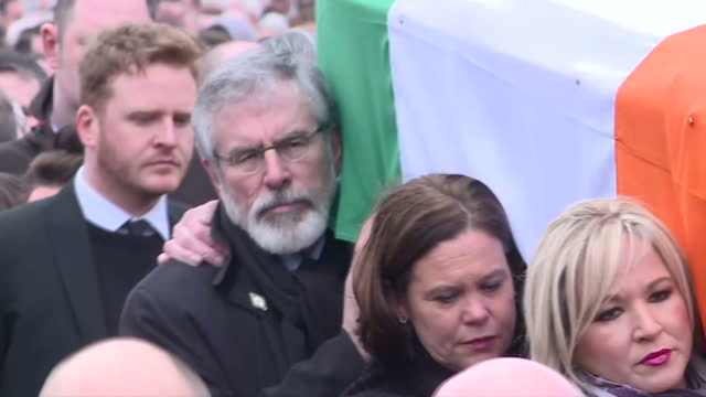 exterior shots of gerry adams sinn fein president and michelle o'neill leader of sinn fein among other mourners carrying the flagdraped coffin of... - derry northern ireland stock videos & royalty-free footage