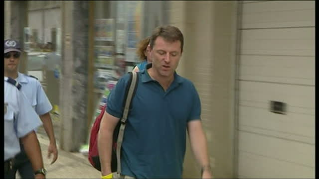 exterior shots of gerry mccann walking into portimao police station where his wife kate mccann is being questioned over the disappearance of their... - madeleine mccann video stock e b–roll