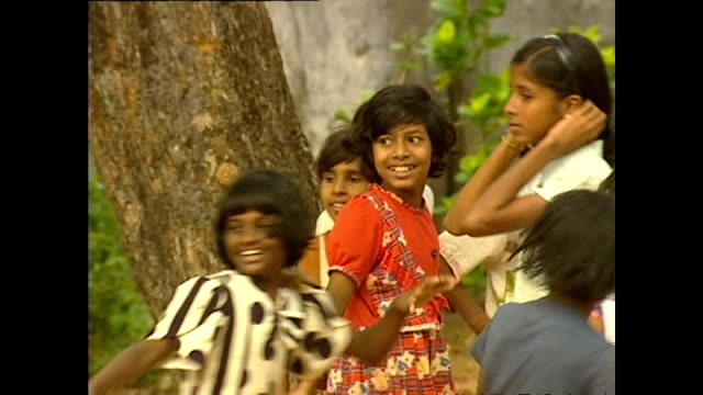 exterior shots of girls playing outside at an orphanage in galle please note it is not clear if these children have been directly affected or lost... - orphanage stock videos and b-roll footage
