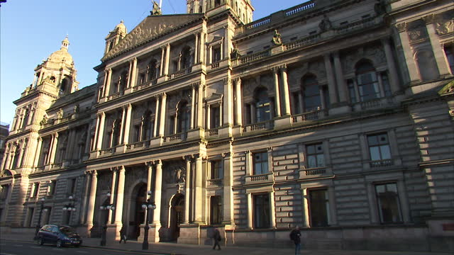 Exterior shots of Glasgow City Chambers building in George Square with the Saltire flown at half mast for Clutha helicopter crash victims Glasgow...