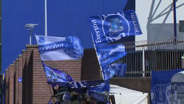 Exterior shots of Goodison Park football stadium including shots of football fans and Everton Football Club signage outside the stadium on April 15...