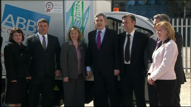 exterior shots of gordon brown posing for a photocall with baroness smith of basildon and members of staff of abby couriers before departing in car... - basildon stock videos & royalty-free footage