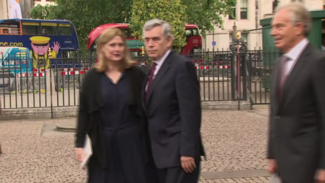 exterior shots of gordon brown with wife sarah followed by tony blair and wife cherie booth walking from westminster abbey after a memorial service... - ゴードン ブラウン点の映像素材/bロール