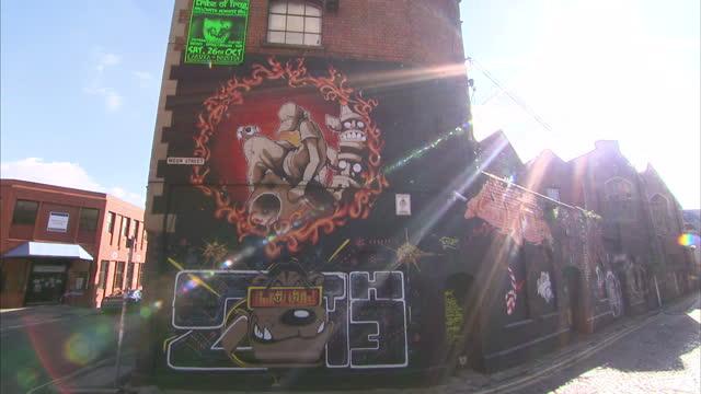 Exterior shots of graffiti street art on sides of buildings in Bristol home of Banksy Street art on buildings in Bristol on October 15 2013 in...