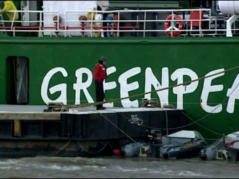 exterior shots of greenpeace ship arctic sunrise on river thames with gherkin building in the background, no new nuclear weapons banner on side of... - greenpeace stock videos & royalty-free footage