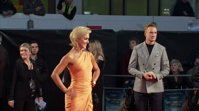 Exterior shots of Greg Rutherford and Natalie Lowe posing for photos on the red carpet at the premiere of Deepwater Horizon at Leicester Square on...