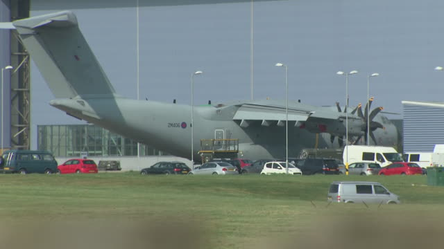 exterior shots of grounded military aircraft at the brize norton raf base and shots of aircraft flying in the sky on 10 april 2020 in brize norton,... - oxfordshire stock videos & royalty-free footage