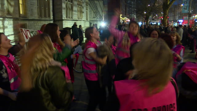 exterior shots of group of campaigners wearing pink banners and high vis jackets cheering and celebrating after the safe zone vote is passed on 10th... - ealing stock videos and b-roll footage