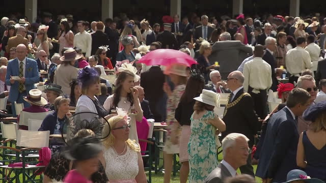 Exterior shots of guests at a garden party hosted by Queen Elizabeth II in the grounds of Buckingham Palace on 1st June 2017 London England
