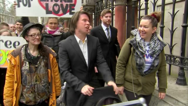 Exterior shots of hacking suspect Lauri Love posing for photographers and speaking with supporters before departing from the Royal Courts of Justice...