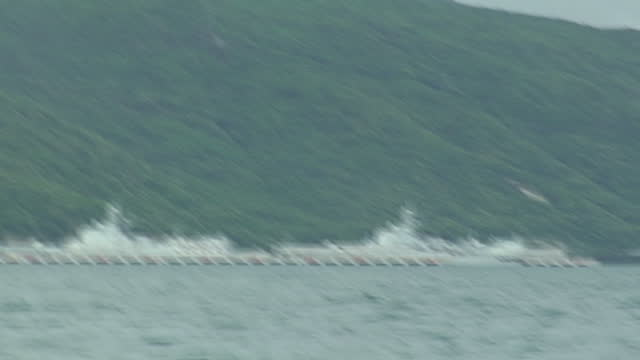 exterior shots of hainan naval base and surrounding naval ships filmed from a boat on july 8 2008 in china - surrounding stock videos and b-roll footage