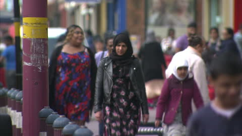 exterior shots of handsworth streetscenes in birmingham showing a rundown poverty stricken area with shutters down on shops and ethnic minorities. on... - handsworth stock videos & royalty-free footage