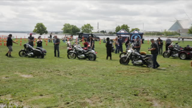 exterior shots of harley davidson enthusiasts and bikes at a showground with various funfair rides and a wall of death show on 29 august 2018 in... - wall of death stock videos & royalty-free footage