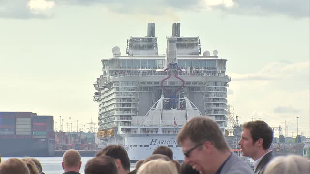 Exterior shots of Harmony of the Seas turning around in Southampton dock watched by crowds of people on dock wall on May 22 2016 in Southampton...