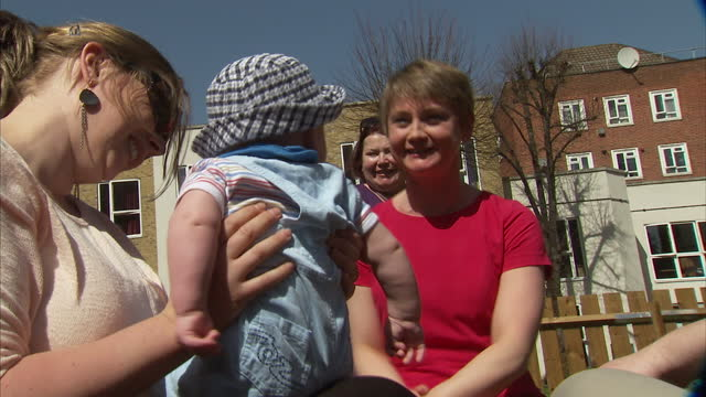 exterior shots of harriet harman, gloria de piero and yvette cooper meeting mothers and children during the launch of the women's manifesto in... - gloria de piero stock videos & royalty-free footage