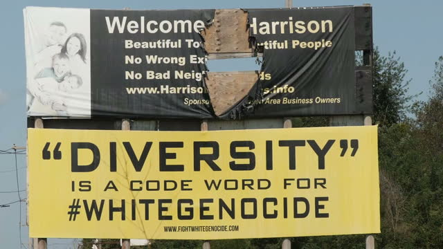 exterior shots of harrison arkansas including shots of a billboard outside the city with the slogan diversity is a code word for white genocide and... - クー・クラックス・クラン点の映像素材/bロール