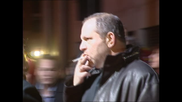 exterior shots of harvey weinstein on the red carpet premiere for the aviator on 19th december 2004 in london england - captain stock videos & royalty-free footage