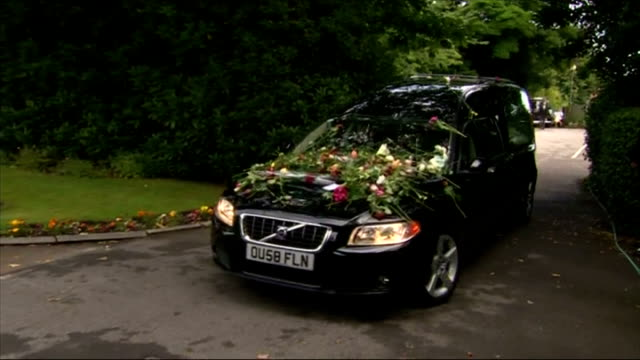 exterior shots of hearse carrying cilla black's coffin arriving at church on august 20 2015 in liverpool england - audio electronics stock videos & royalty-free footage