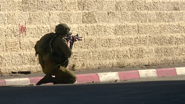 exterior shots of heavy military presence on the streets of jerusalem with israeli troops are firing tear gas and sponge bullets as violent protests... - jerusalem stock videos & royalty-free footage