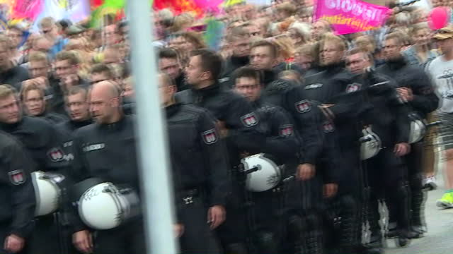 exterior shots of heavy police security during a protest march near the g20 summit on july 08 2017 in hamburg germany - group of 20 stock videos & royalty-free footage