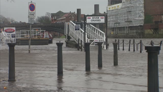 exterior shots of high water on the river ouse beginning to flood riverside paths in york. heavy winds & rain causing floods & travel disruption on... - river ouse stock videos & royalty-free footage