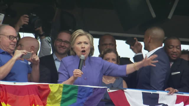 Exterior shots of Hillary Clinton waving from a balcony to crowds of cheering supporters chanting 'Hillary Hillary' on October 30 2016 in Ft...