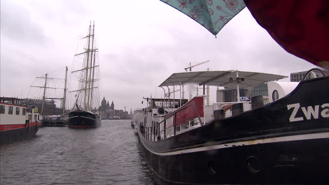 Exterior shots of historic ships docked at the National Maritime Museum and barges aboard the canals on March 16 2010 in Amsterdam Netherlands